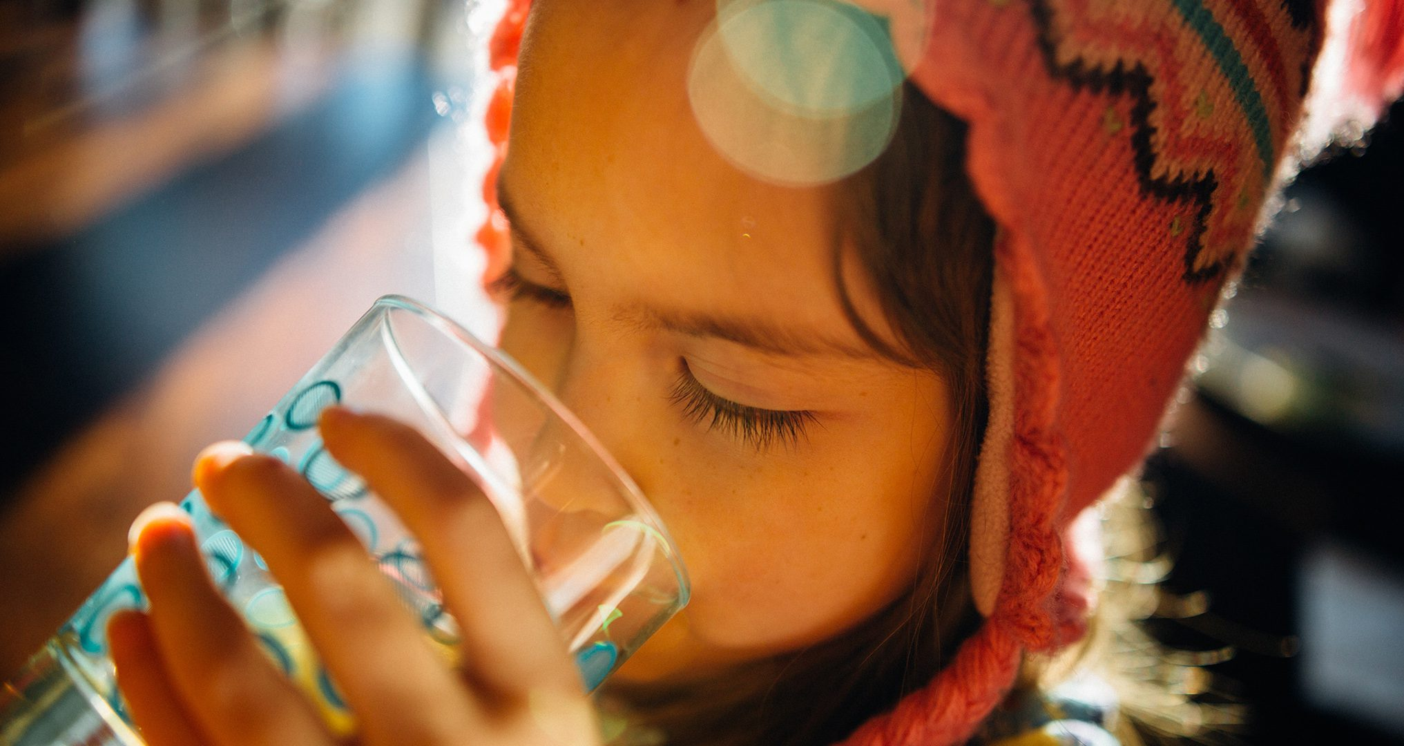 child enjoying fresh water